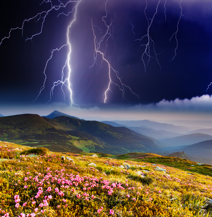 Thunderstorm with lightning in mountain landscape. Dramatic sky. Carpathian, Ukraine.